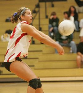 6OCT09  Elyria's Kristen Boros defends against a Mustang service.  photo by Chuck Humel