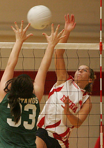 6OCT09  Elyria's Kristen Boros hits a blistering shot past Mustang's #33 Mandi Peterlin to win game 1.  photo by Chuck Humel