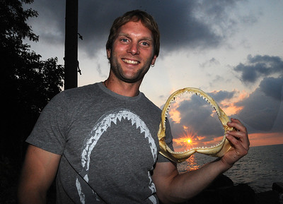 "Lorain native Taylor Chapple, featured on Discovery Channel's ""Shark Week,""  holds a sandbox shark's jaw from the Gulf of Mexico, at his home in Lorain on Aug. 14.      Steve Manheim"