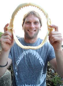 """Lorain native Taylor Chapple, featured on Discovery Channel's """"Shark Week,""""  holds a sandbox shark's jaw from the Gulf of Mexico, at his home in Lorain on Aug. 14.      Steve Manheim"""