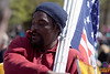 A flag vendor at the Tea Party Express III sells Gadsden and modern flags, large and small, on the Boston Common. Without a doubt, many of the flags represented on the common were likely sold by this man.