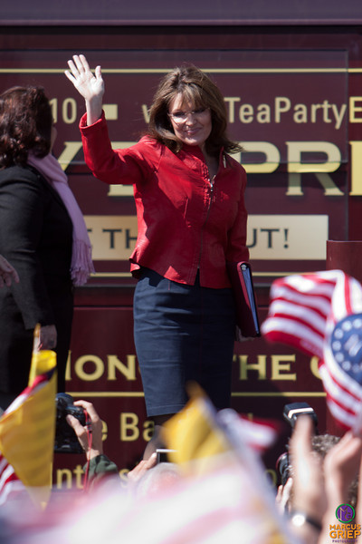 Gov. Sarah Palin waves to the crowd as she steps onto the stage at the Tea Party Express III stop on the Boston Common.