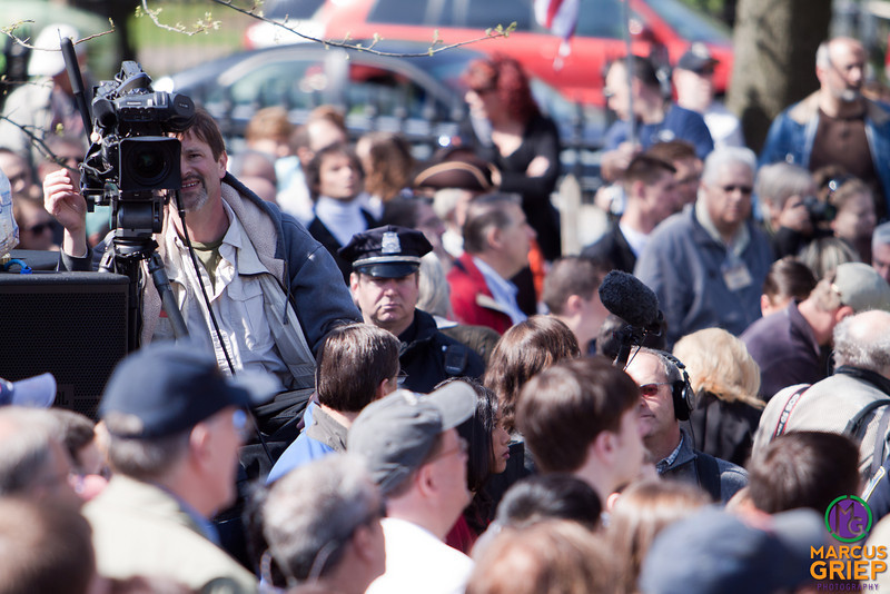 A narrow depth of field captures a cameraman and mic-boom operator as they film the crowd at the tea party gathering on the Boston Common.