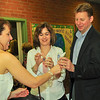 "Event chairperson Kristy Thomson offers Paula and Keith Isoldi special wine glasses at ""A Taste of Italy"" to commemorate the St. Margaret School Centenial Celebration."
