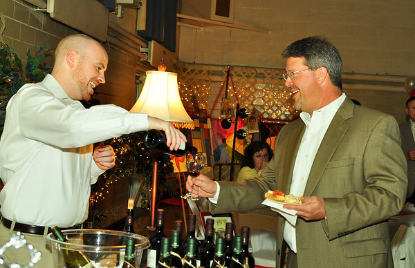 "John Zimmer recieves a glass of wine during ""A Taste of Italy"" wine tasting hosted by St. Margaret School in celebration of 100 years of education."