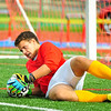 Calvert Hall's goalie John Dillon makes a diving save during a 2-0 defeat over John Carroll.