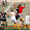 John Dillon (red shirt) of Calvert Hall makes a leaping save in a match against John Carroll.