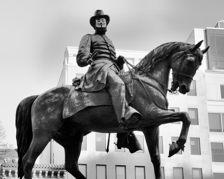 Guy Fawkes mask on statue of General McPherson