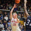 Brady Bechtel shoots over an Elkhart Central defender during the game Friday at North Side Gym.