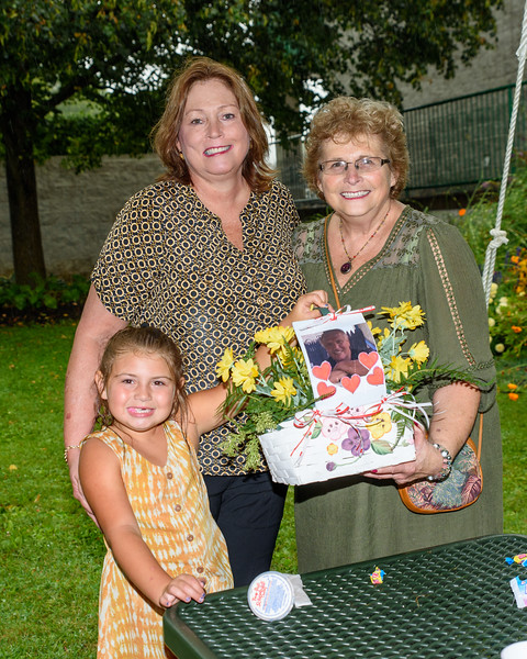 Jeanne McNeill, her granddaughter Kenzie and Sandy Superka, who made the nice flower basket with Danny's photo in it.