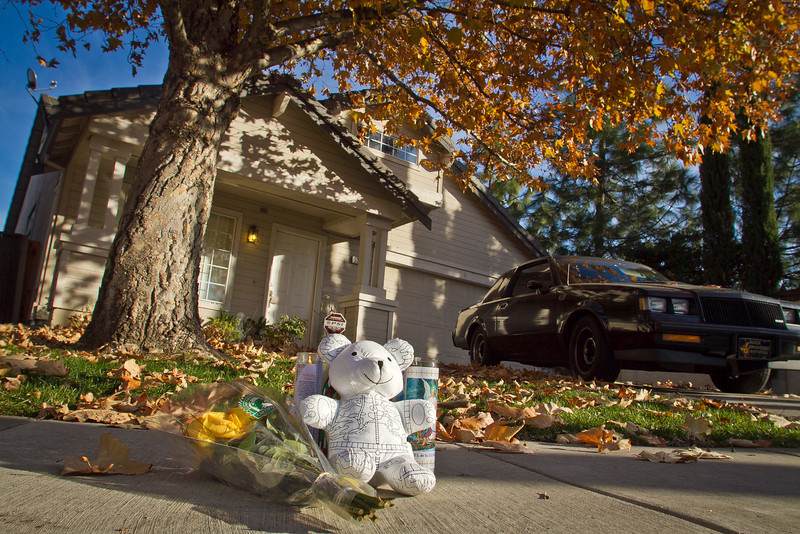 Flowers, candles and a Teddy Bear at a memorial for a 2 year old boy that was run over by a truck near his home in Antioch, Calif., on Tuesday, December 27, 2011.