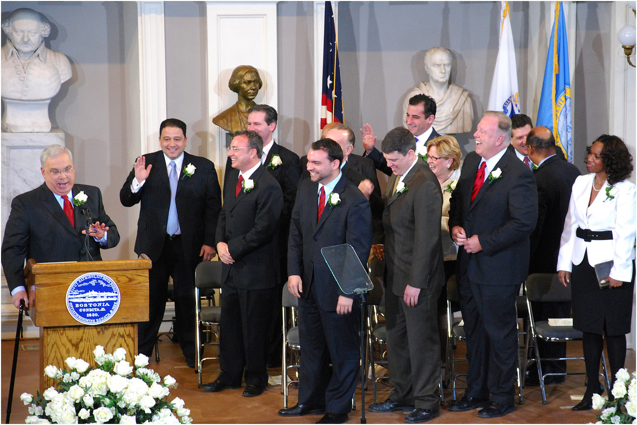 Sharing a laugh with City Councilors in January 2010, after inadvertantly swearing them in as mayor.