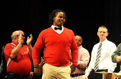 Tracy Sprinkle of Elyria football walks on stage to receive 2012 Golden Helment Award on Nov. 15.  Steve Manheim