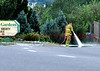 A Firefighter from Colorado Springs Fire Engine 7's Crew is seen doing cleanup on the street at the scene of a traffic accident in front of Phelan Gardens on Austin Bluffs Parkway in Colorado Springs, Colorado, USA.