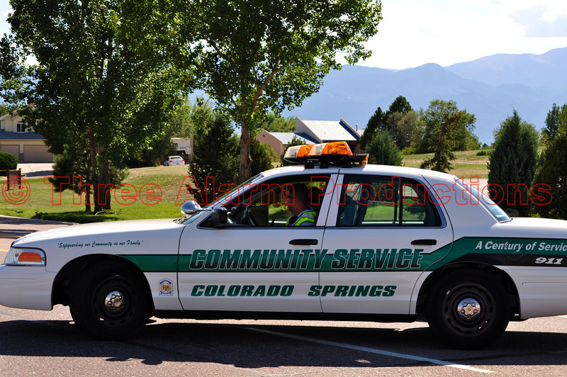 Colorado Springs Community Service Officers assisting with traffic control at the scene of a traffic accident on Austin Bluffs Parkway.