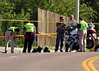 The Police Motorcycle Unit of Colorado Springs Police Officer Matthew Tyner, who was involved in a traffic collision with a pickup truck on July 24th, 2012. Investigators are seen collecting evidence at the scene.