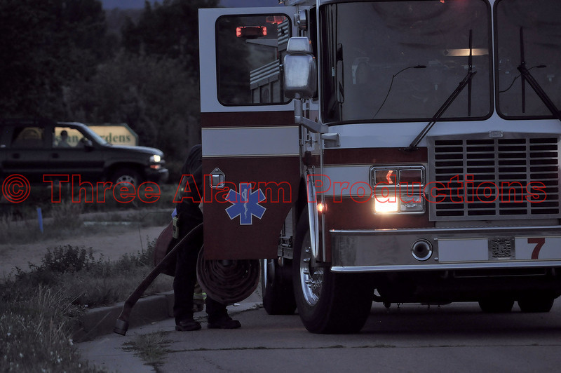 Colorado Springs Fire Engine 7 finishing cleanup at the scene of the accident.