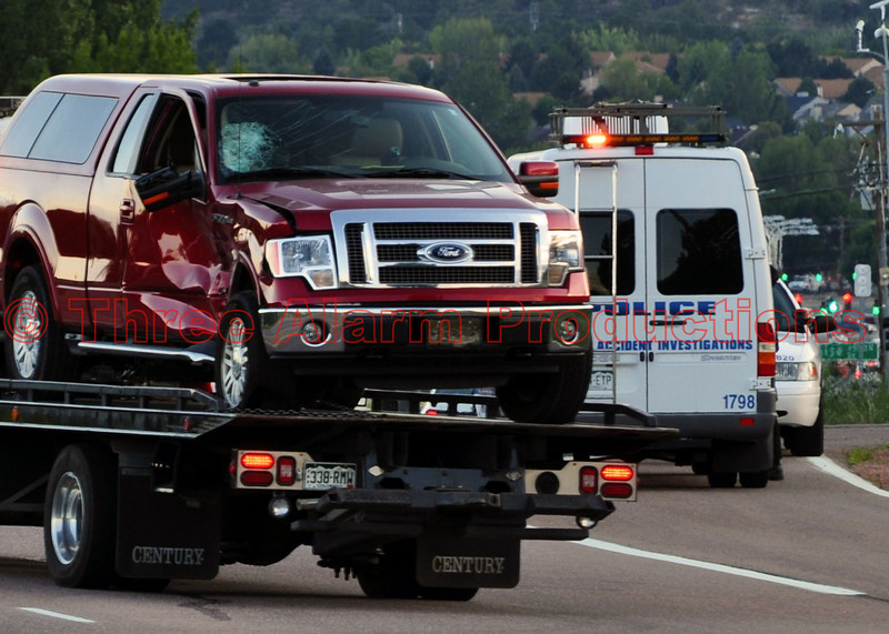The pickup truck on the tow truck that was struck on its passenger side by a Colorado Springs Police Motorcycle Unit. Police Officer Matthew Tyner was later pronounced dead at Memorial Hospital, due to injuries sustained in the crash. No details were released on possible injuries of the person or persons that were in the pickup truck.