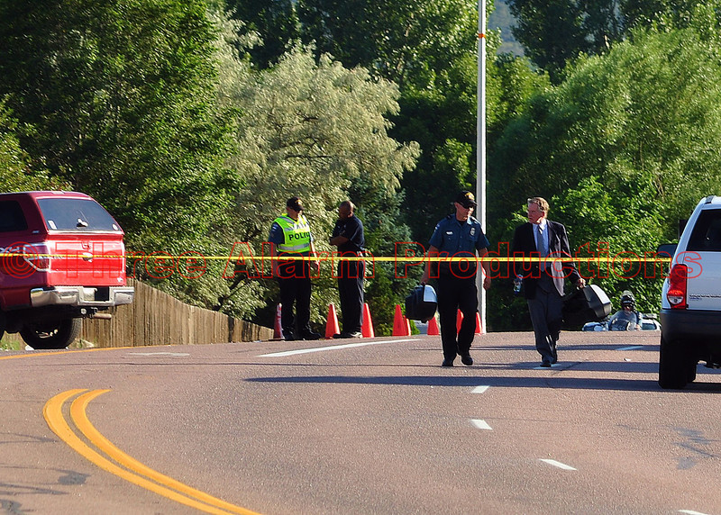 "Investigators working on the scene of a traffic accident, on Austin Bluffs Parkway, involving a police fatality.<br /> >>><br /> City of Colorado Springs Mayor, Steve Bach, released a statement about the traffic accident, ""Few things are as heartbreaking as the passing of one of our brave and dedicated police officers. A member of our City family, Officer Matthew Tyner, served on the Colorado Springs Police force for nearly 14 years. Tragically, his life ended today while he was conducting traffic enforcement near Austin Bluffs Parkway and Silver Drive.  An accident that will affect his family and friends for the rest of their lives causes us all to realize how precious life is. This has been a sad and difficult summer for Colorado Springs and, in fact, our whole state – many will join us in mourning the loss of Officer Tyner.  We will pray for him, his family, his friends and colleagues.  God bless this dedicated officer who died while serving our city."""