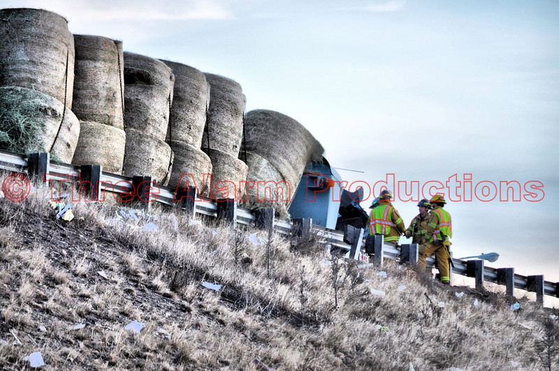 Colorado Springs Fire Fighters assessing the fuel spill from the tractor-trailer's fuel tanks. The truck flipped and landed on its side and came to a rest against the guard rail on the Interstate.