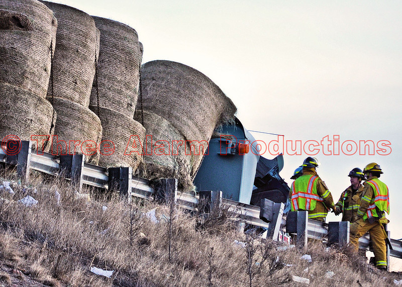 The remainder of the hay load stayed secured during the cleanup stages.