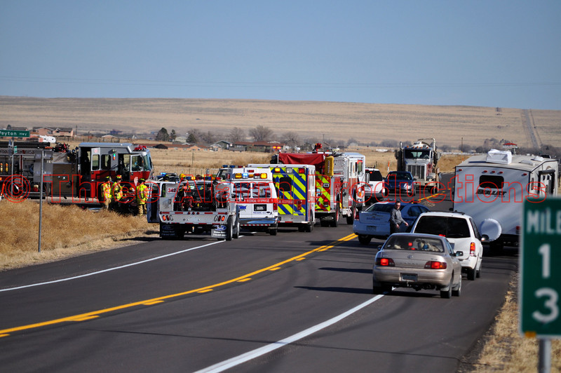 """On the afternoon of November 21st, 2012, Ellicott Fire Protection District responded to a report of a 2 vehicle traffic accident at Peyton Highway and Colorado Highway 94 in Eastern El Paso County. See location on Google Maps at <a href=""""http://goo.gl/maps/KNR4D"""">http://goo.gl/maps/KNR4D</a><br /> Two priority response medical helicopters were called to the scene by """"Highway 94 Command"""". On the highway, the Toyota Camry was heavily damaged by high-speed impact made with a Chevrolet 2500 HD pick-up truck. Two patients were reported trapped in the wreckage at the scene. Mutual aid response was initiated from nearby Schriever Air Force Base Engine 5 and Falcon Fire Protection District Engine 313, to assist with extrication efforts and multiple-patient care on scene. Multiple ground ambulances and paramedics via AMR were also utilized on scene. Patient care was executed very effectively with multiple agencies working together at the accident scene. Several State Patrol Units and El Paso County Sheriff Units were on scene for safety and highway traffic control. Colorado State Patrol Officers worked on the accident investigation and cause."""