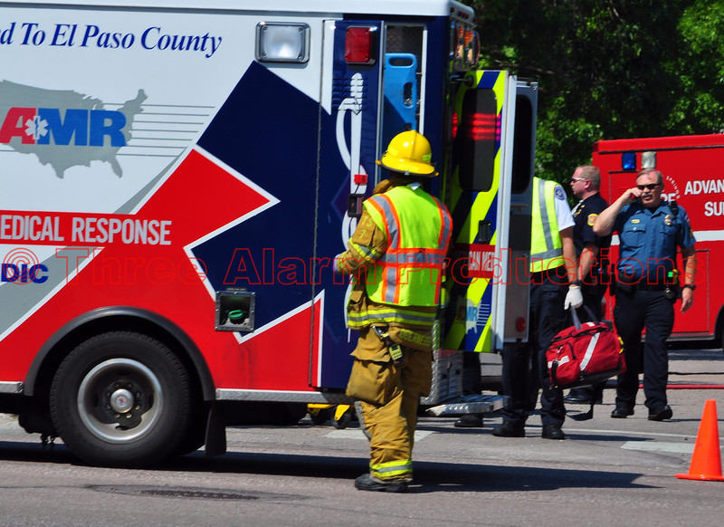 Emergency personnel on the scene of a traffic accident at North Murray Boulevard and Sawyer Way in Colorado Springs, Colorado.