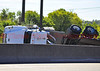 This flatbed semi-truck was carrying a load of plastic pipes, that went all over Interstate 25, after it rolled over, snarling traffic all day.