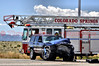 Colorado Springs Fire Department's Ladder Truck 8 seen in the background at a high impact collision at Space Village Ave. & Marksheffel Road.