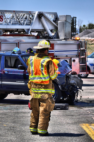 Cimarron Hills Fire Chief Matt Love on the scene of a high impact vehicle collision.