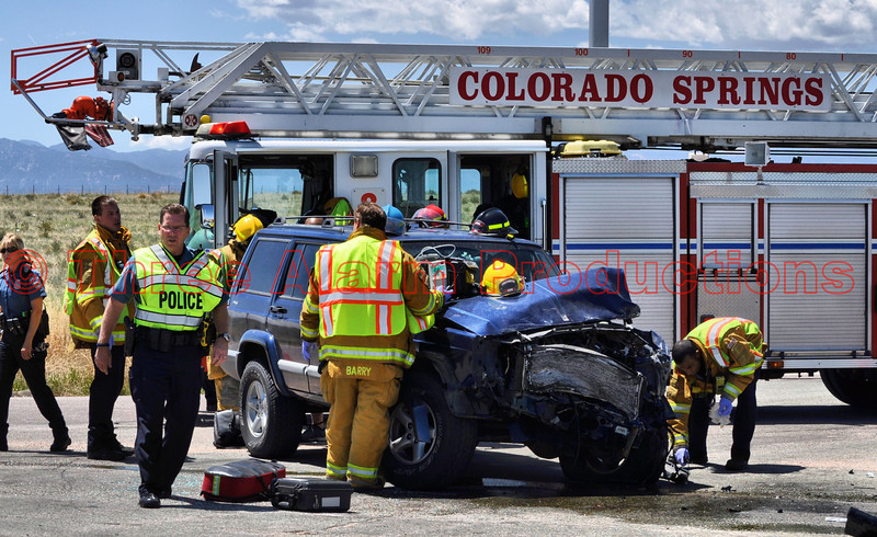 Colorado Springs Fire Department's Ladder Truck 8 with crew on the scene of a traffic accident.
