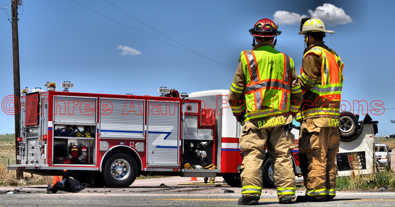 Cimarron Hills Fire Engine 1310 on the scene of a traffic accident with injuries. (L) Lieutenant Matt Rasdall and (R) Chief Matt Love make observations of the scene.