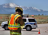 Chief Love on the scene of a traffic accident. Pikes Peak Mountain in the background.