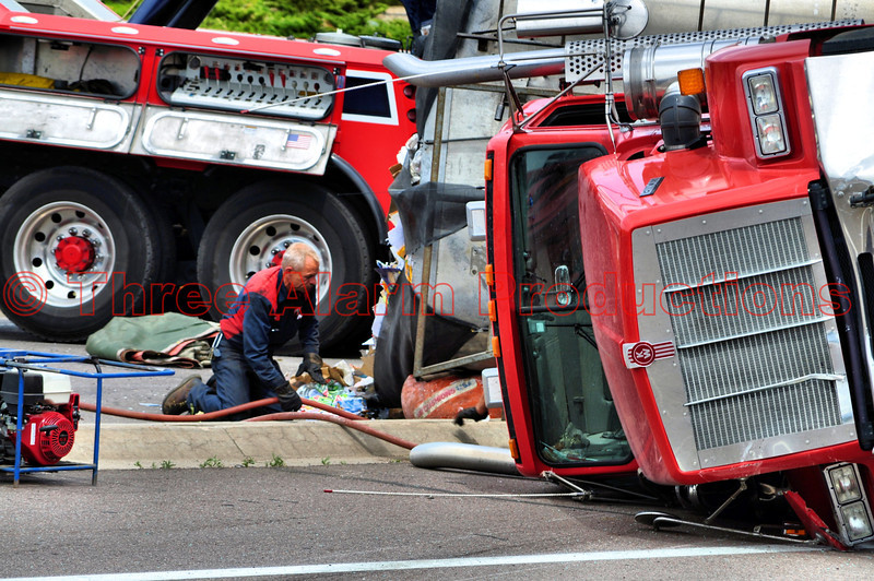 Three heavy-duty tow trucks were brought in from Randy's Towing to upright the damaged tractor-trailer on Fountain Blvd. in Colorado Springs, Colorado USA.