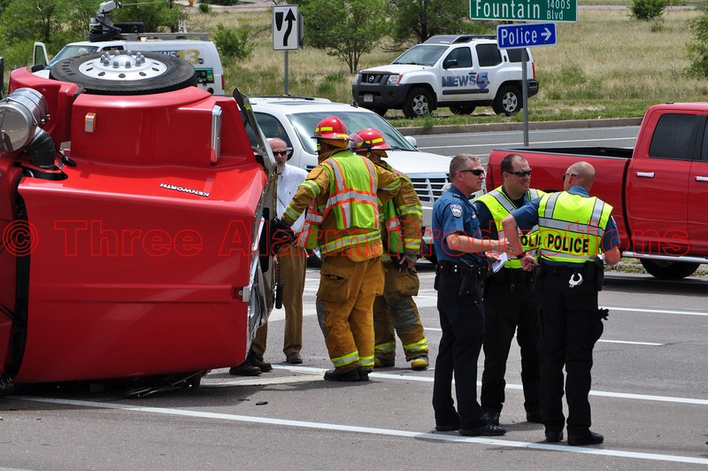 Colorado Springs Police Officers gathering information on the scene of a traffic accident.