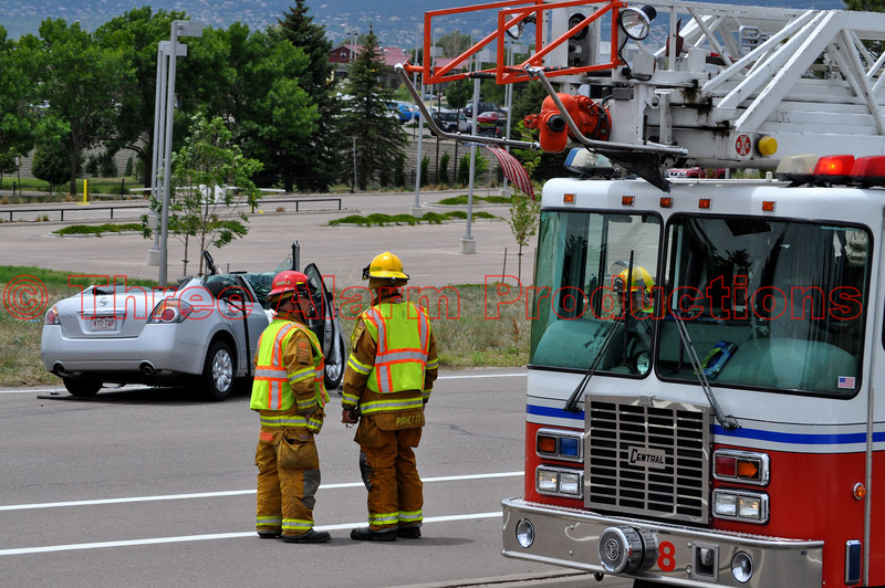 Colorado Springs Fire Department's Truck 8 on the scene of a traffic accident involving a car and a tractor trailer.