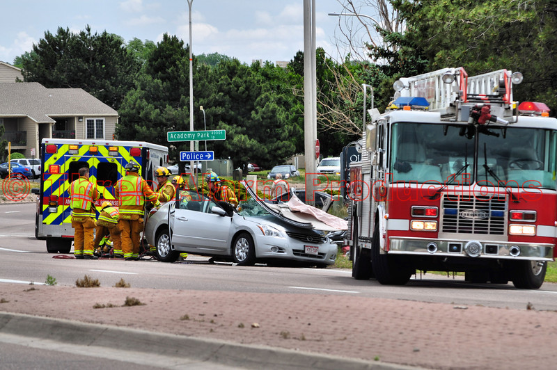 Colorado Springs Fire Fighters doing a final load up of a patient that needed to be extricated from a vehicle that collided with a tractor trailer.