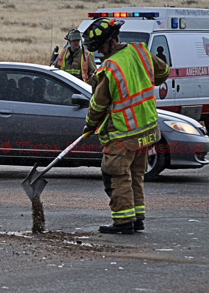 A CHFD Firefighter controlling fluids leaking from the vehicle accident.