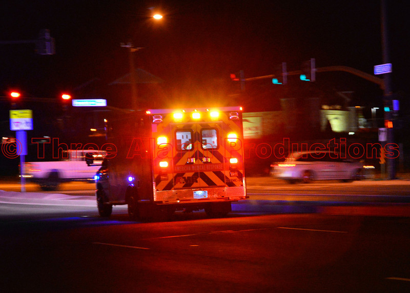 AMR Ambulance transporting a patient from the scene of a traffic accident on Research Parkway.