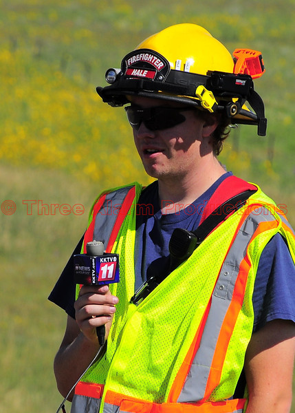 "Peyton Firefighter Hale, giving a news interview with ""News 11 KKTV"", on the tractor-trailer roll-over on U.S. Highway 24, in El Paso County, Colorado. Date of Incident-August 27, 2013"