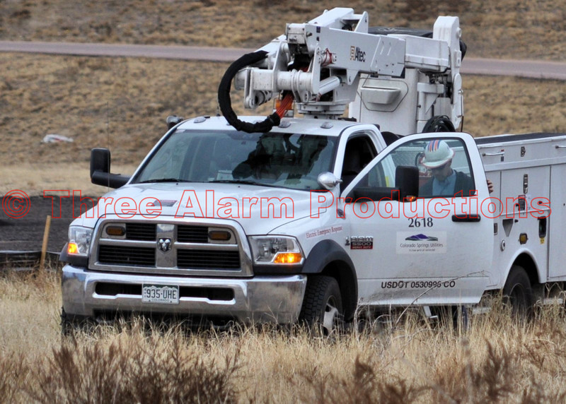 Electric Emergency Response Crew from Colorado Springs Utilities, on the scene of a downed utility pole from a traffic accident on Powers Boulevard.