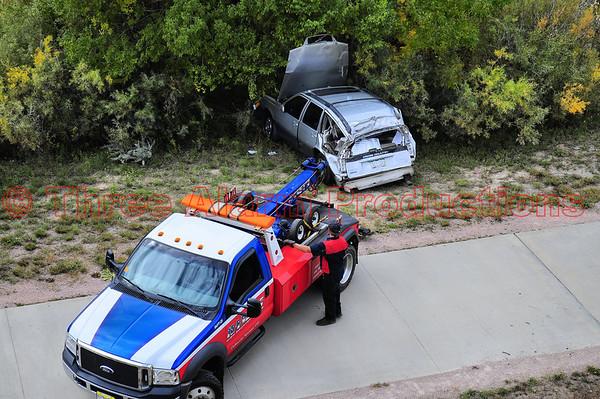 Vehicle goes over embankment-Colorado Springs-CSFD