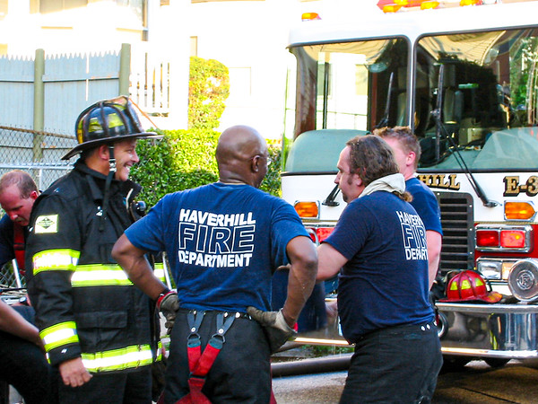 Fire fighters cool down after a two-alarm blaze at 11 Union St. in Haverhill, MA.
