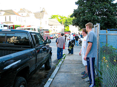 A crowd forms as fire fighters get a two-alarm blaze under control at 11 Union St. in Haverhill, MA.