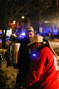 Salvation Army volunteers hand out coffee at a two-alarm blaze at 27 5th Ave. in Haverhill, MA.