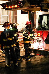 Fire fighters battle a two-alarm blaze at 27 5th Ave. in Haverhill, MA.