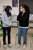 Moosonee Cree Opera Pimooteewin: Northern Lights Secondary School Workshop with Grade 9 girls and stage manager Sam Joyce and tenor Bud Roach - students Abigail Linklater and Megan Hunter discuss an aspect of the workshop.
