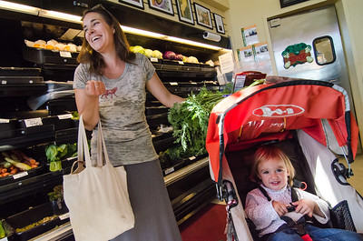 Young mother Katie Hart explains why she likes Mandela Foods as an alternative to Whole Foods, while her daughter Ella (18 months) waits for mom to finish shopping