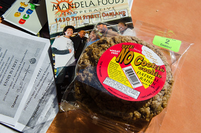 Cookies made in Oakland – containing NO industrial sugar, NO milk, NO eggs – basking in the sun on a countertop in the Mandela Foods market. (Hey, it's California!)