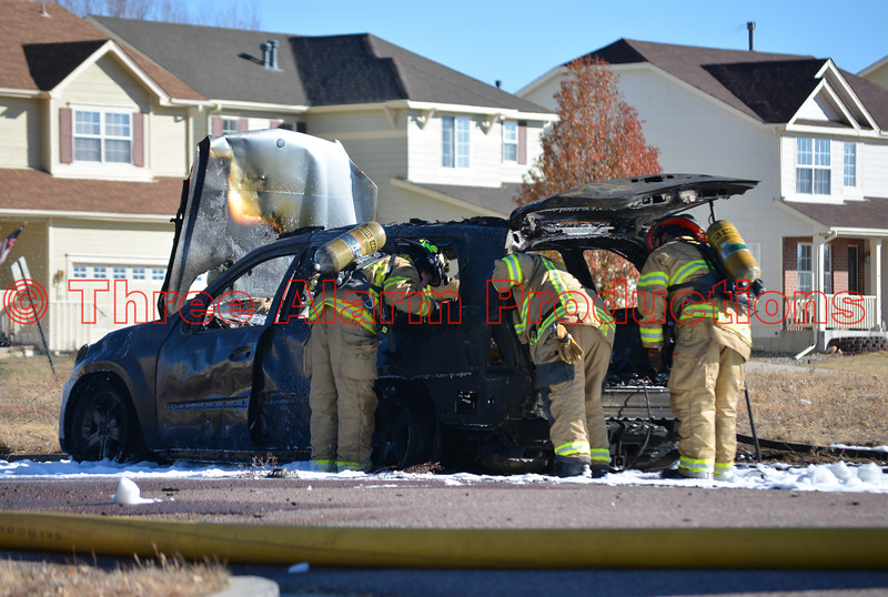Firefighters inspecting the remains of an suv that was fully involved with fire. November 23, 2016